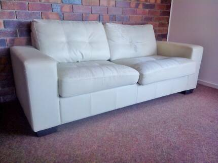 Cream 2 seater leather look sofa bed