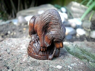 Hand Carved wood netsuke Dog plays with basket collectable boxwood canine figure