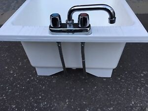 Brand new laundry sink and faucet