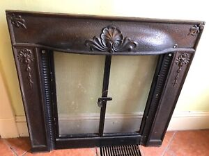 Cast iron fireplace grate cover
