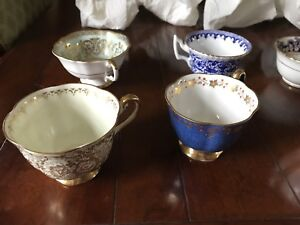 Bone China Made in England. 7 tea cups and saucers.