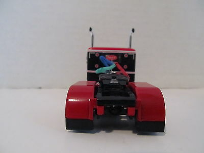 DCP 1/64 SCALE 379 PETERBILT (DAY CAB OPT) RED/BLACK WITH WHITE STRIPE  2