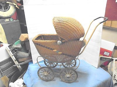 "vintage brown wicker baby buggy metal spoked wheels 27"" tall child's toy"