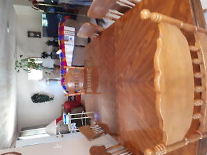 For Sale Solid wood table and 8 chairs 250 OBO