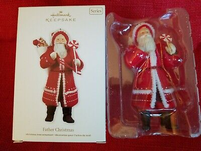 2011 Hallmark Ornament FATHER CHRISTMAS #8 Red Coat w/ Lollipop Sweet Treats -