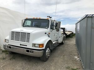 1999 International 4700 Crew Can with 25' trailer