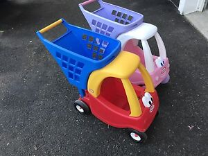 His and Hers Little Tikes shopping carts