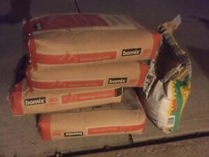 Four bags of bomix concrete mix