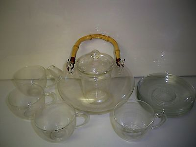 Teaposey Tea For More Teapot with four cups and four saucers
