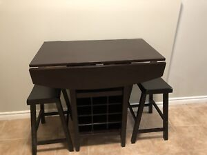 Bar table with wine rack and stools