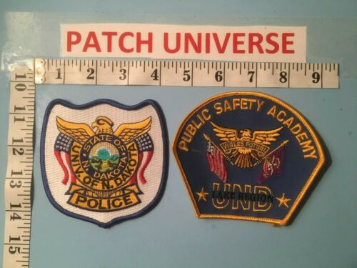 TWO DIFFERENT UNIVERSITY OF NORTH DAKOTA  SHOULDER PATCHES   I034