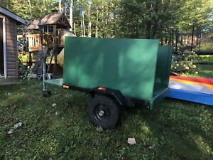 Cool little utility trailer. Good for camping