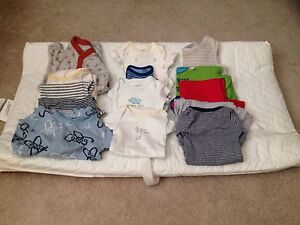 New born clothing and diaper changing pad
