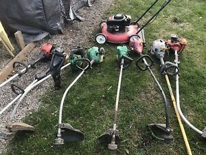 9 trimmers and one mower $100 obo.