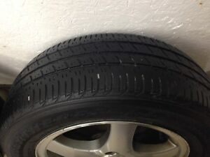 3 winter tires with 4 rims