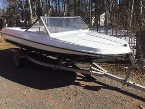 Sunray boat, trailer and outboard.