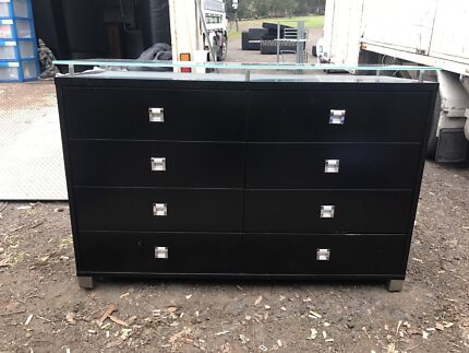 Black solid timber chest of draws with glass top