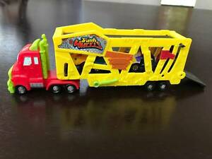 The Trash Pack Trash Wheels Muck Mover with 4 extra Trash