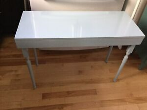 Light blue low hall table. - available