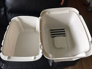 Two large litter boxes