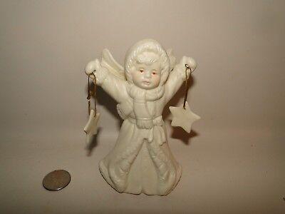 Angel Holding Star Figurine - Kirkland's Angel Holding Stars figurine