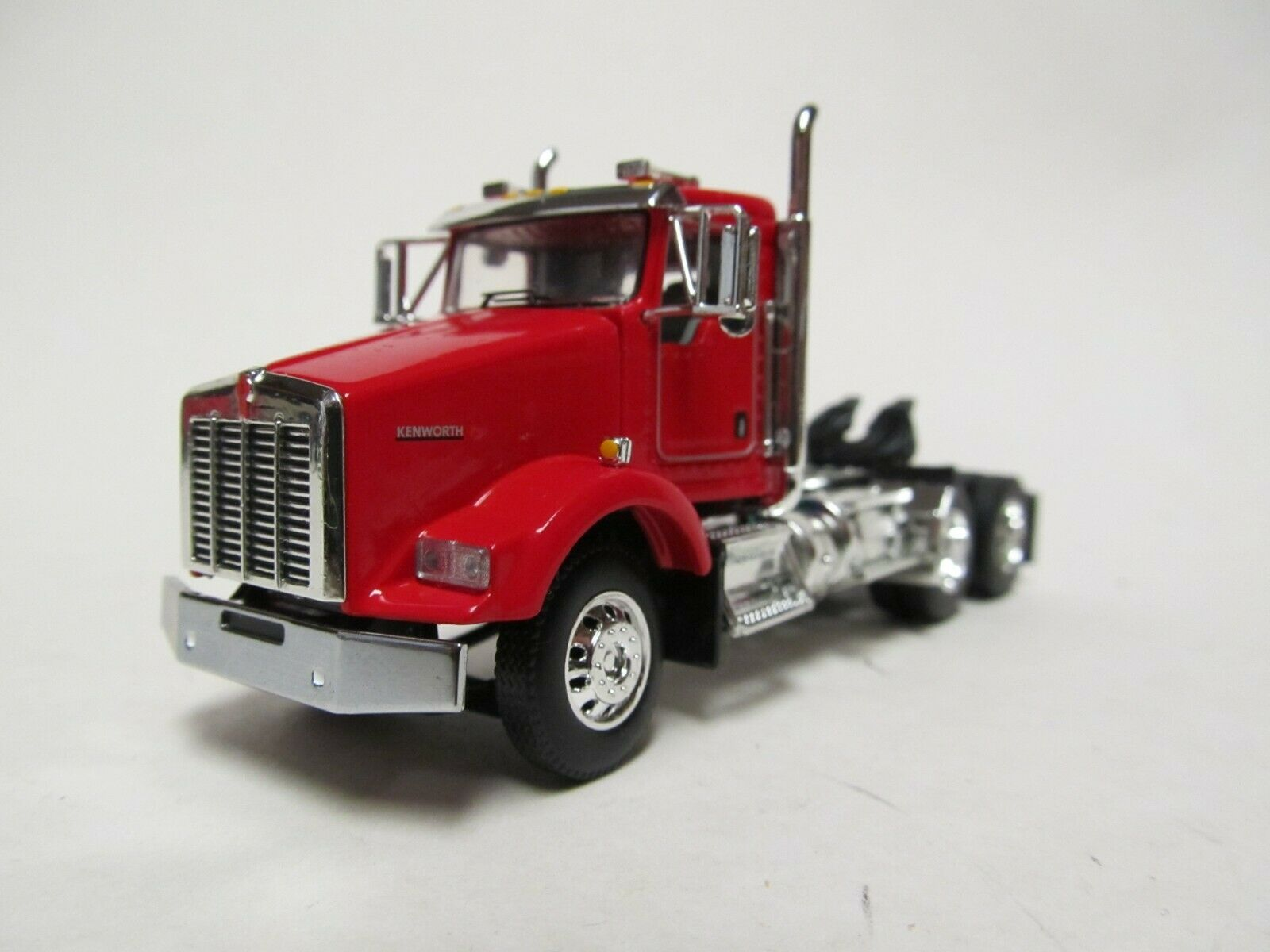 DCP / FIRST GEAR 1/64 SCALE T-800 KENWORTH DAY CAB RED & CHROME, BLACK FRAME