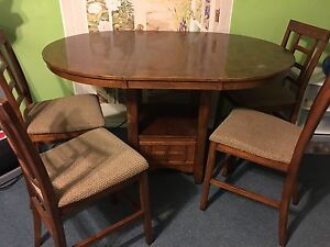 Oak table and chairs with insert