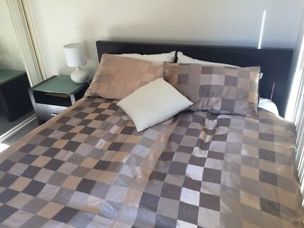 Queen size bed with mattress and two bedside tables