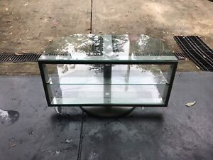 Glass and metal swivel TV unit