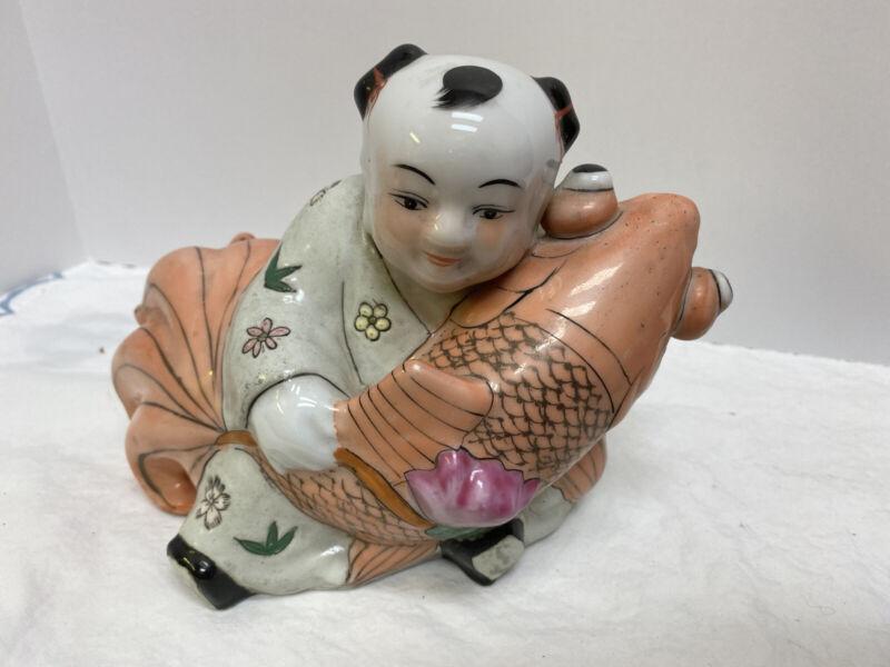 Antique Porcelain oriental Asian boy koi fish Statue