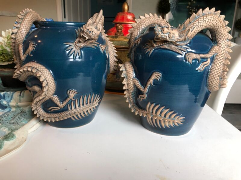 Maitland Smith Two Blue Ceramic Vase With Teo Large Terra Cotta Dragons.