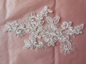 An ivory(soft white) bridal cord lace Applique/motif for sale.Sold by piece(s)