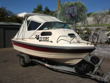 Swiftcraft Kingfisher Cabin Cruiser for fishing/skiing.