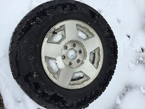 2006 Chevy 1500 rims and tires.
