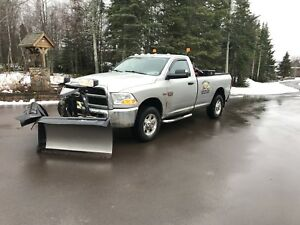 2012 Dodge 2500  with 8 foot six fisher minute mount V plow