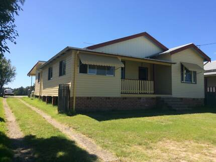 1622 sqm Riverfront property with large home and commercial sheds