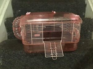 Pink hamster cage comes with bowl and bottle