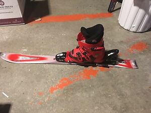 Beginner skis with boots and helmet