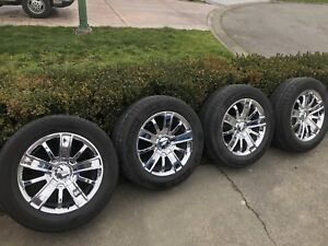 """20"""" chrome Chevy rims and tires"""