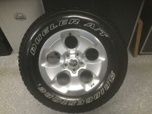 Jeep Wrangler Bridgestone Dueler Tire with Rim P255/70R18