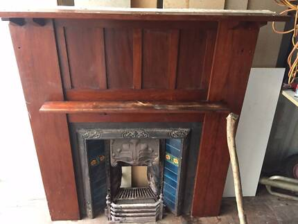 Victorian tiled fireplace with mantle. Cast iron.