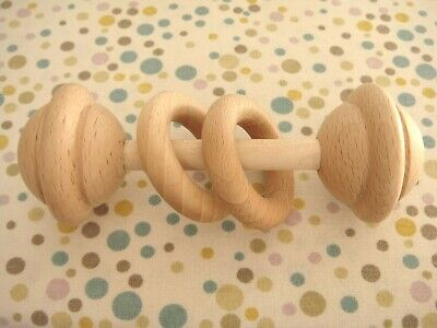 Organic Wooden baby Rattle toy with teething rings, made in Europe