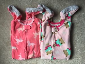 2x like-new Carter's microfleece footed sleepers - 12 months