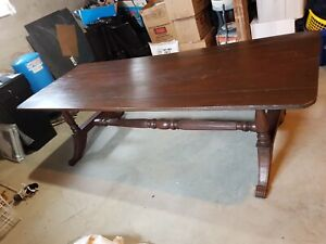 9 foot harvest table and 7 chairs