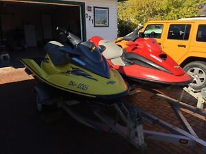 Two 2001 seadoos and trailer.