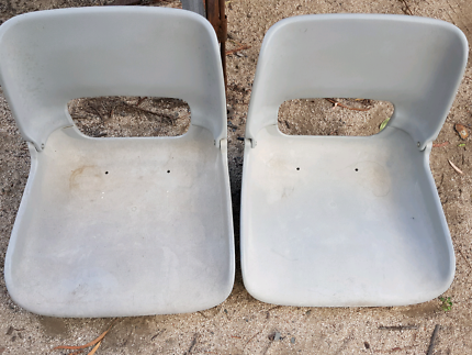 Two folding boat chairs