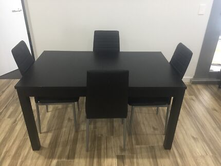 Black Bjursta extendable dining table with 4  Chairs