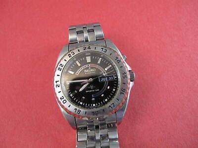 seiko 5m43 0a99 black dial sports 100 on bracelet  NO RESERVE