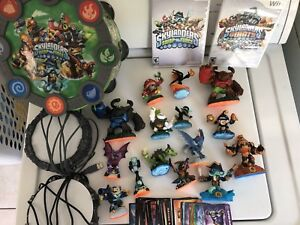 Skylanders lot with carry case, 2 portals and trading cards