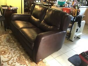 Two deep brown  leather recliner and  one love seat